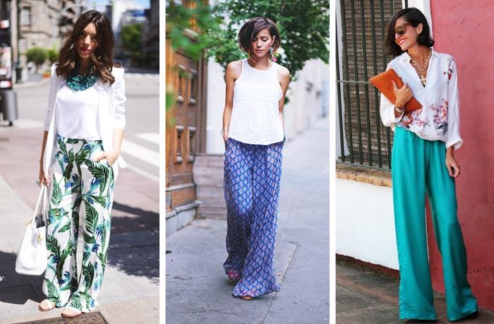 modèle de pantalon fluide blanc à motifs tropicaux assorti avec top blanc et blazer blanc combinés avec collier vert