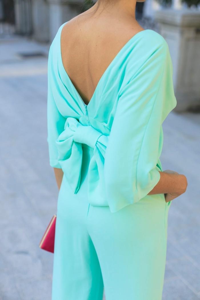 exemple de tenue habillée femme en combinaison élégante et stylée de couleur vert, modèle d'ensemble pantalon avec top à dos noeud